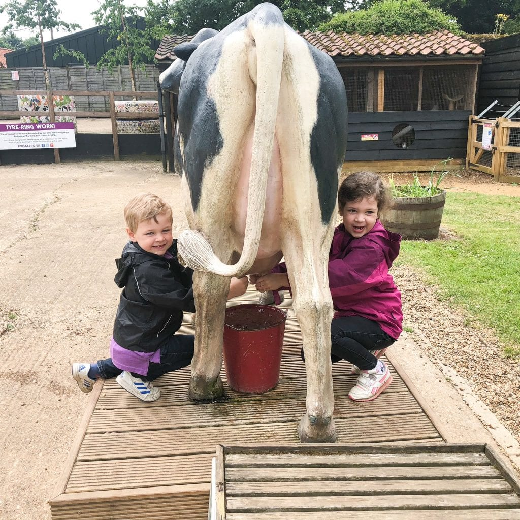 Kids milking the 'faux' cow