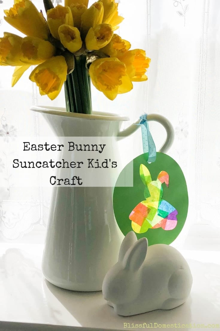 Easter bunny suncatcher decorating a vase with daffodils pin