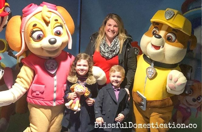 Me and my children standing with the Paw Patrol pups Skye and Rubble before the Paw Patrol movie starts.