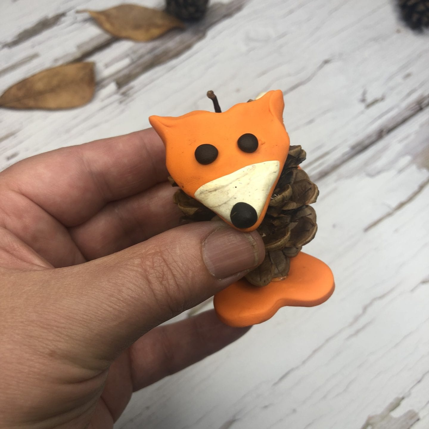 pine cone and polymer clay fox