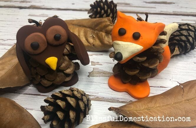 Pine cone and polymer clay animals featured image