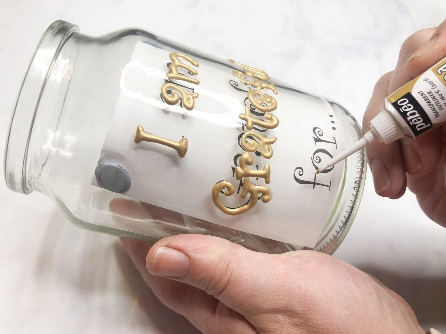 Writing on the galss jar with relief paste