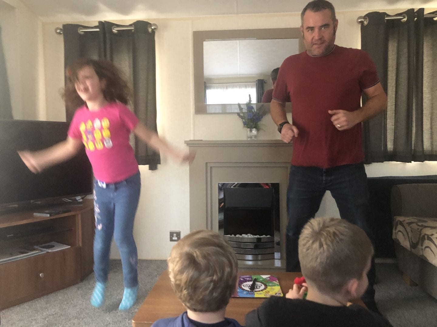 Isla and her Daddy head to head in a round of Shake Off