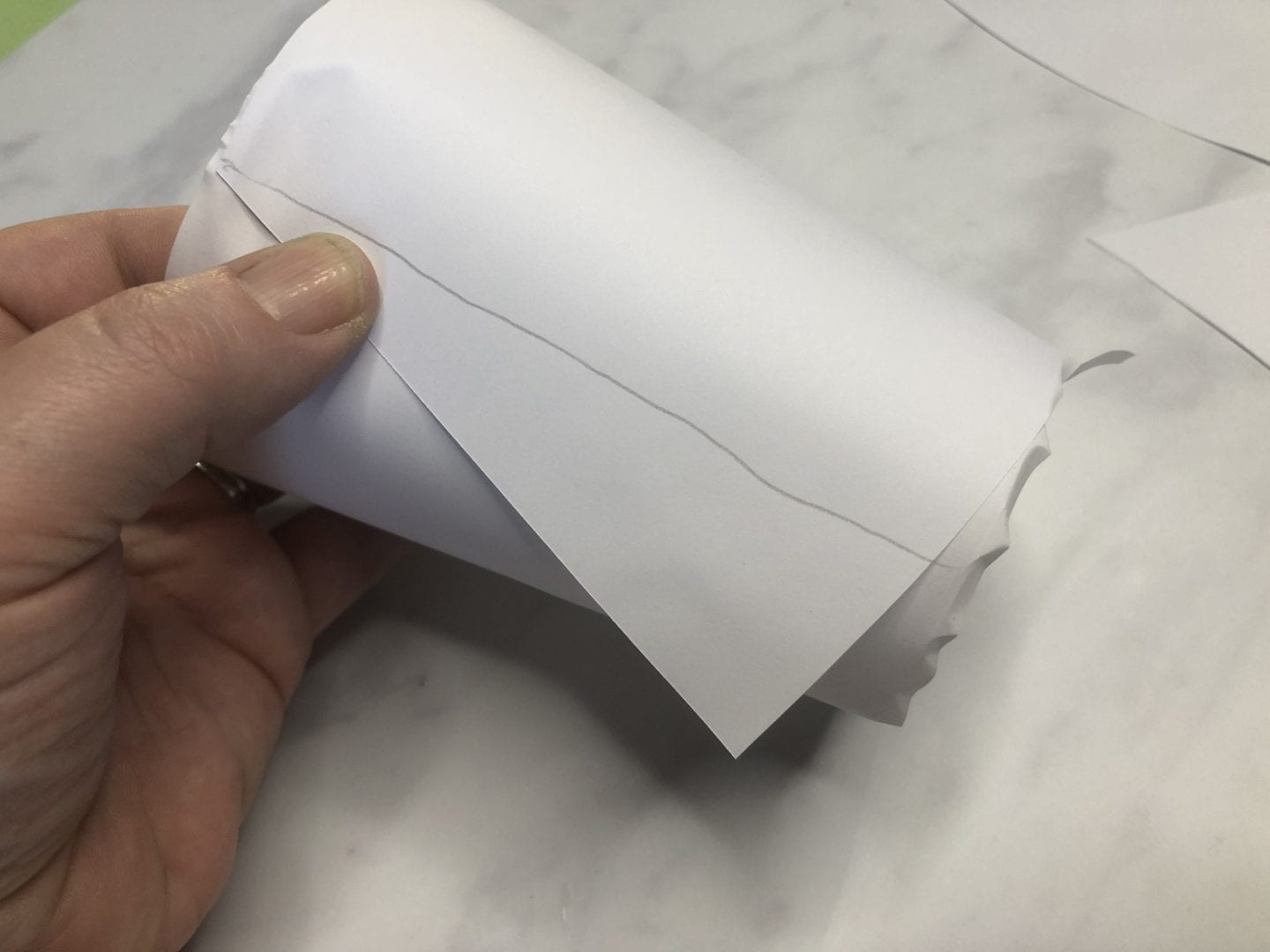 drawing a line down the edge of the template to complete it